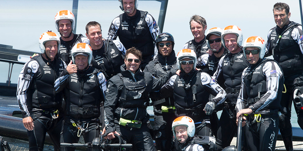 Loading Tom Cruise with  Emirates Team New Zealand. Photo / ETNZ