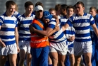 St Kentigern College players make a beeline for the coaching staff after winning the Auckland 1A secondary schools rugby competition. Photo / Greg Bowker