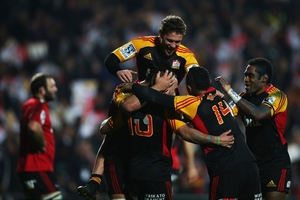 Aaron Cruden celebrates with his Chiefs teammates after scoring a try against the Crusaders. Photo / Getty Images