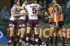 Jamie Lyon of the Sea Eagles celebrates with his teammates after scoring a try against the Wests Tigers. Photo / Getty Images
