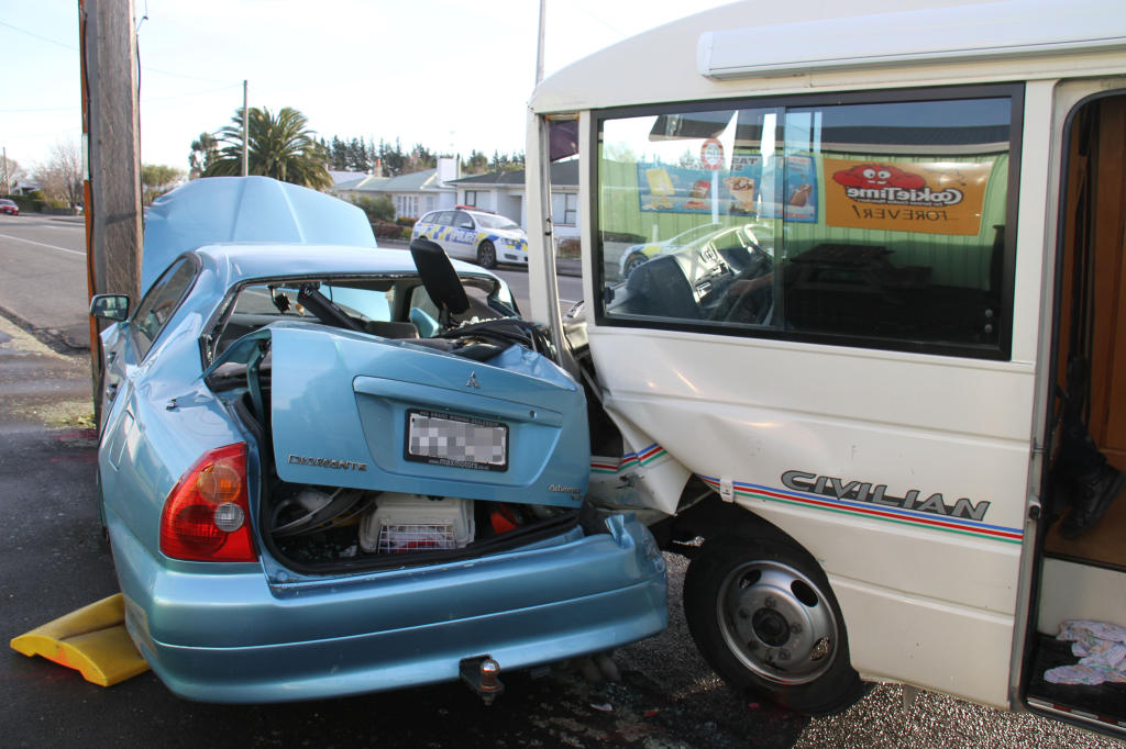 wta270713abcrash02.jpg A campervan collides with a parked car in Carterton, after the campervan was involved in a two-vehicle collision at an intersection earlier.WMM 29Jul13 - SQUASH: The motorhome embedded against a parked car, just as a family of three