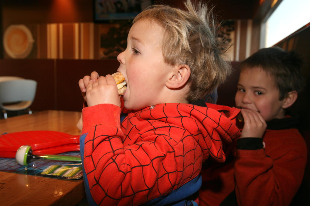 wta290713lfmuffin01.jpg Masterton pre-schooler Hunter Smith, 3, takes a big bite of his free bacon and egg McMuffin alongside his seven-year-old brother Oliver, who also was enjoying a hearty breakfast during celebrations at McDonald's Family Restaurant i