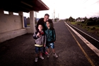 Jamie-Lee Johnson with sons Jade (left), 7, and Justin, 10, says Transdev's CCTV footage clearly shows she tried to get on the train. Photo / Dean Purcell