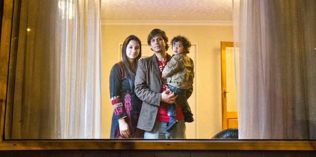 Shish Rawat, here with wife Neelam Sajwan and son Nivesh Rawat, found a note on his dining table saying DTR staff had entered his home. Photo / Greg Bowker