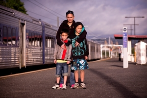Jamie-Lee Johnson with sons Jade, left, and Justin at Te Mahia railway station. Photo / Dean Purcell