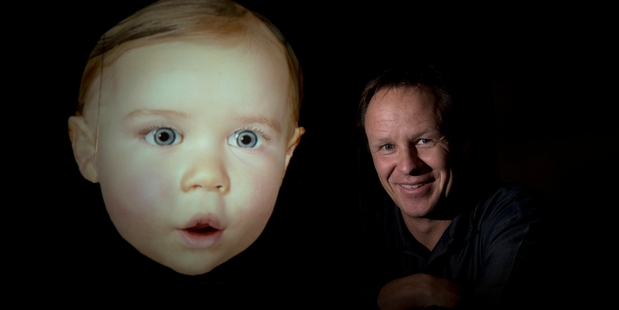 Dr Mark Sagar with Baby X, a computer-driven simulation based on his own daughter. Photo / Brett Phibbs