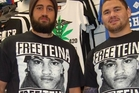 Warriors players Ben Matulino and Russell Packer wear Free Teina  T-shirts.