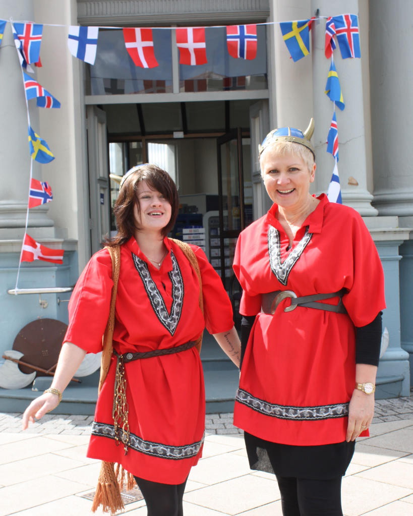 Kimberley Stevens (left) and Lianne Simpkin of the Tararua District Council in front of the Scandi decorated BNZ.