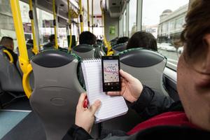 Journalist Cherie Howie monitors bus speeds. Photo / Michael Craig