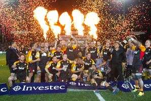 Chiefs players celebrate after beating the Brumbies. Photo / Alan Gibson