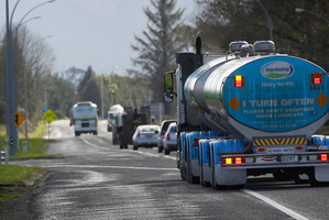A Milk tanker signals to turn into the Te Rapa Fonterra Dairy Factory. Photo / Christine Cornege.