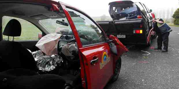 Eight people were hospitalised after this two car crash on Tuhikaramea Rd this morning. Photo / Christine Cornege