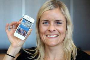 Dr Helen Eyles of the National Institute for Health Innovations shows the food package scanning iPhone app Foodswitch.Photo / Chris Gorman