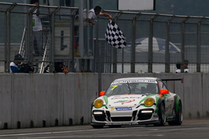 The chequered flag puts New Zealander Earl Bamber in centre spot on the winners podium again in the Carrera Cup series, which he now leads.