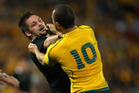 The confrontations between Richie McCaw and Quade Cooper typify the nastiness thathas crept into tests between the All Blacks and Wallabies. Photo / Getty Images