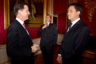 Ed Miliband (right) with the Coalition's Nick Clegg (left) and David Cameron. Photo / AP