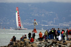 Spectators on shore watch as Luna Rossa Challenge of Italy, heads for the leeward marks during their America's Cup challenger series semifinal race against Artemis Racing of Sweden. Photo / AP.
