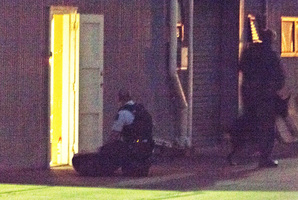 Police arrest a man with fire arms in Onekawa after he fired a gun at a neighbours building. Photo / Hawke's Bay Today