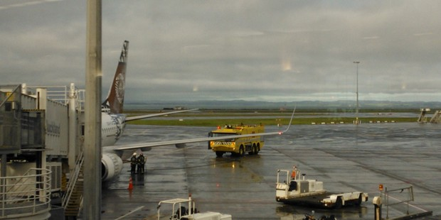 The Fiji Airways plane at Auckland Airport with emergency services close-by. Photo / supplied