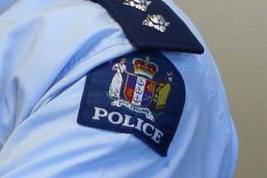 A police officer has been charged over an assault at a football game. Photo / File