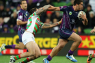 Kenneath Bromwich of the Storm breaks a tackle applied by Nathan Peats of the Rabbitohs during the round 22 NRL match between the Melbourne Storm and the South Sydney Rabbitohs. Photo / Getty.