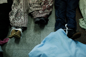 Feet from the bodies of supporters of deposed Egyptian President Mohammed Morsi lie on the floor of the Rabaa al-Adaweya Medical Centre. Photo / Getty Images