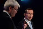 Tony Abbott (right) seemed more comfortable, while incumbent Kevin Rudd appeared a bit lost but more prime ministerial. Photo / AP