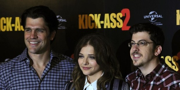 US director Jeff Wadlow and US actors Chloe Grace Moretz and Christopher Mintz-Plasse mark the UK launch of the film Kick Ass 2. Photo / AFP