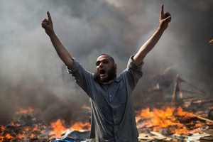 A supporter of ousted Islamist President Mohammed Morsi shouts during clashes with Egyptian security forces in Cairo's Nasr City district, Egypt. Photo / AP