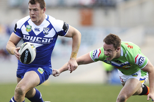 Josh Morris of the Bulldogs runs the ball during the round 23 NRL match between the Canberra Raiders and the Canterbury Bulldogs. Photo / Getty Images.