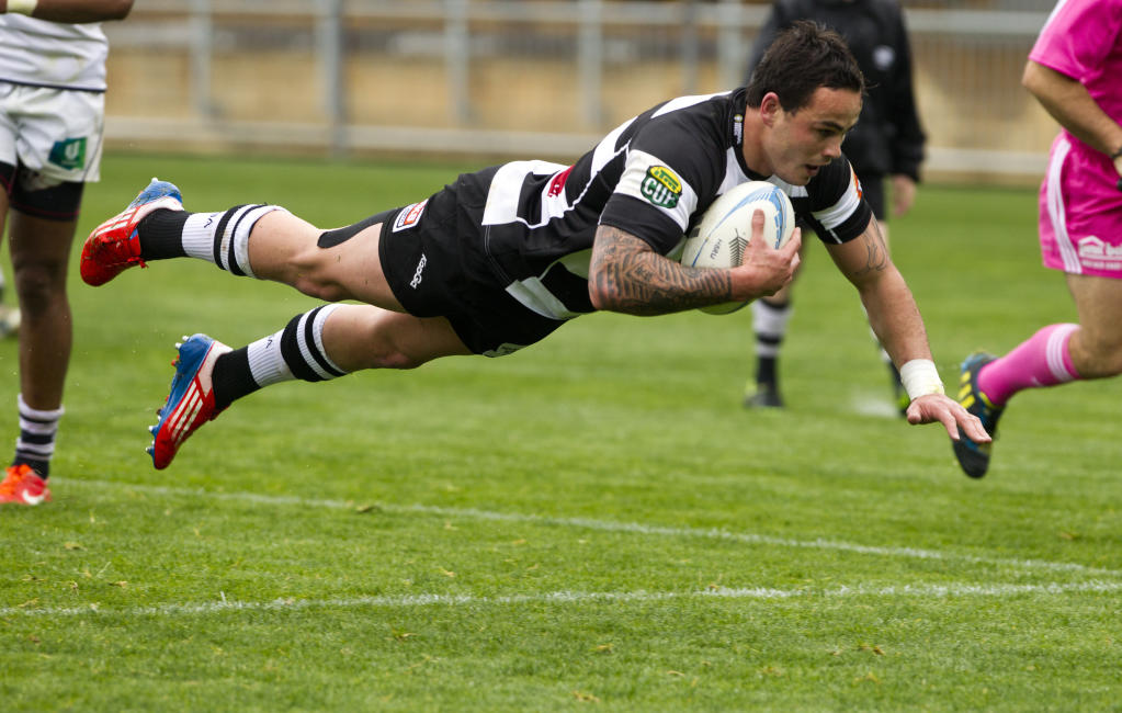 Hawke's Bay Magpies rugby winger Zac Guildford scores the second of his three tries during the Magpies victory.