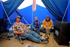 Andrew Johnston (right) of 3 Clifford St, with his neighbours David and Susanne Carrick, in his tent where he and his wife slept last night after the Seddon earthquake struck. Photo / Tim Cuff