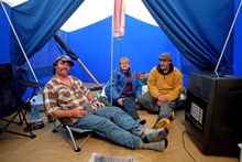Andrew Johnston (right) of 3 Clifford St, with neighbours David and Susanne Carrick of number 1, in his tent. Photo / Tim Cuff