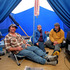 Andrew Johnston (right) of 3 Clifford St, with neighbours David and Susanne Carrick, in his tent where he and his wife slept last night after the Seddon earthquake struck. Photo / Tim Cuff