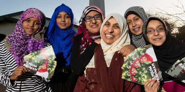 Anjum Rahman, centre with light scarf, with supporters, from left, Suad Guya, Khatra Omar, Aaminah Ghani, Sarah Ather and Aasiya Ather. Photo / Stephen Barker