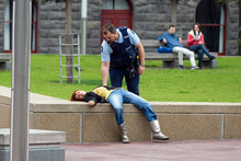 Ten minutes passed before anyone checked on a scruffy 'comatose' woman - and that was a cop. Photo / Michael Craig.