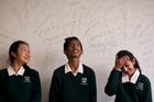 Lynfield College students (from left) Isabel Yu and Rupin Kumar, both 13 and Elysha Negi, 14, will be competing in a National Spelling Bee regional final in Auckland this weekend. Photo / Dean Purcell