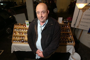 Graeme Cunningham with his jam stall at the Frank Kitts Park Underground Markets. Photo / Hagan Hopkins