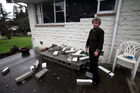 Dawn Daunauda seen outside 17 Clifford Street, Seddon, with earthquake damage. Photo / Tim Cuff