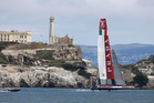 Luna Rossa Challenge of Italy, makes its way past Alcatraz Island for the leeward marks during their America's Cup challenger series semifinal race against Artemis Racing. Photo / AP