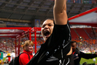 Valerie Adams' charisma had the Moscow crowd celebrating her fourth World Championships gold medal with her. Photo / AP