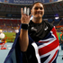 Valerie Adams holds up four fingers for photographers, representing he four consecutive world title, as she celebrates her gold medal in the women's shot put final at the World Athletics. Photo / AP