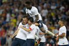 England's Rickie Lambert, left, celebrates with teammates after scoring a goal during an international friendly soccer match between England and Scotland at Wembley Stadium in London. Photo / AP