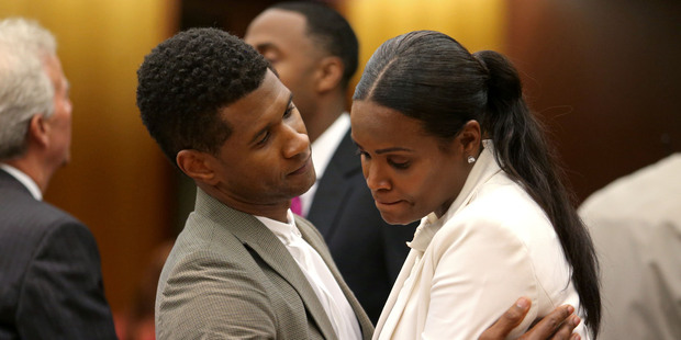 Singer Usher Raymond IV talks with his ex-wife Tameka Raymond after the judge ruled in Usher's favor keeping custody of their two sons. Photo / AP