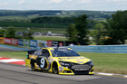 Marcos Ambrose (9) drives during qualifying for Sunday's NASCAR Sprint Cup Series auto race, Saturday Aug. 10, 2013. Photo / AP