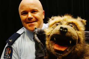 "Senior constable Bryan Ward, with his ""dog"" Bobby, says filming the clip was a lot of fun. Photo / Greg Bowker"