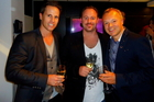 Invivo Wines' Tim Lightbourne and Rob Cameron share a drink with Graham Norton. Photo / Invivo Wines