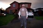 Darren Priest outside his home in Flat Bush where his rates have increased by 18.6 per cent. Photo / Dean Purcell