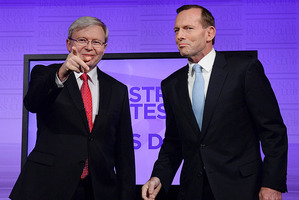 Australia's Prime Minister Kevin Rudd, left, and opposition leader Tony Abbott pose during the Leaders Debate last night. Photo / AP