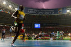 French photographer Olivier Morin manages to capture a lightning bolt as Usain Bolt won the 100m in Moscow. Photo / AFP